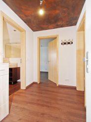 2-Zimmer-Erdgeschosswohnung mit Südgarten in Oberhaching